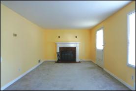 Adrienne van Dooren's living room before floor restoration. Photo credit: David Galen